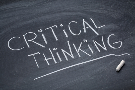 Critical thinking - white chalk handwriting on a blackboard