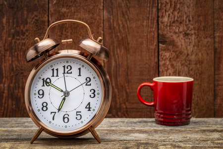 alarm clock and a cup of coffee Stock Photo
