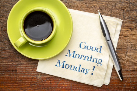 Good Morning Monday - handwriting on a napkin with a cup of coffee Stock Photo