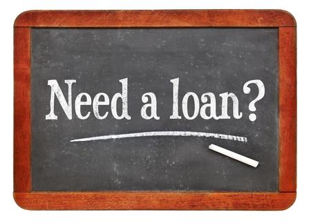 Need a loan? Blackboard sign - white chalk text on a vintage slate blackboard.
