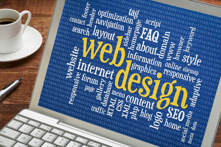 web design and development word cloud with binary background on a laptop screen