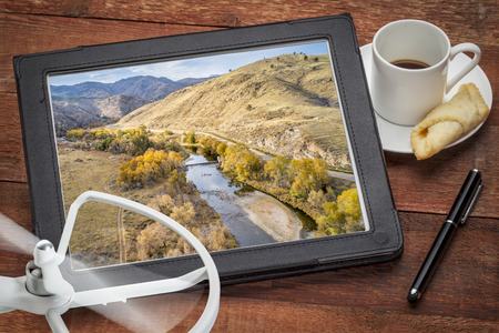 Cache la Poudre River at a canyon mouth above Fort Collins, Colorado in a  fall scenery, reviewing an aerial image on a digital tablet Stock Photo