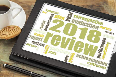 2018 year review word cloud on a digital  tablet with a cup of tea Stock Photo