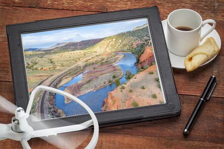 upper Colorado River below McCoy, Colorado - rewieining and editing aerial image on a digital tablet