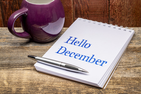 Hello December  - text in a sketchbook with a mug og hot tea or coffee