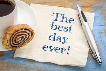 The best day ever! Positive handwriting on a napkin with a cup of coffee