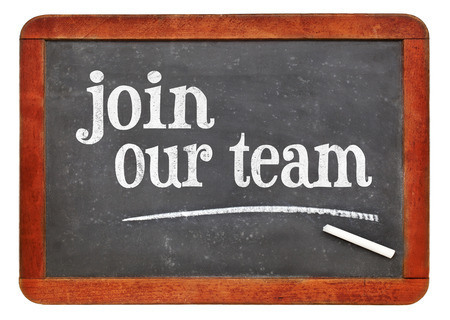 Join our team sign - white chalk text on a vintage slate blackboard