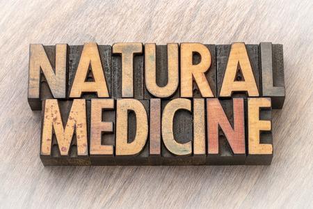 natural medicine - word abstract in vintage letterpress wood type printing blocks