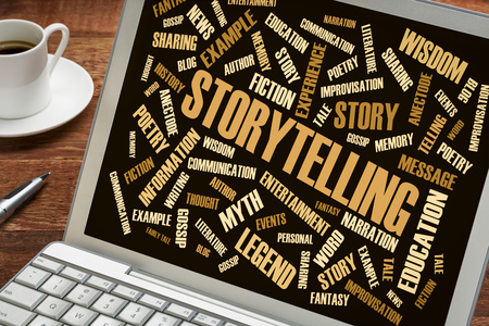 storytelling word cloud on a laptop with a cup of coffee