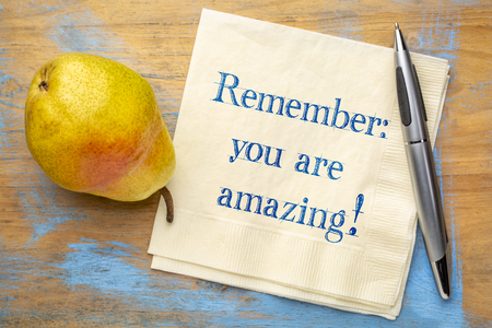Remember - you are amazing! Inspirational handwriting on a napkin