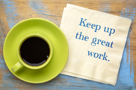 Keep up the great work - handwriting on napkin with a cup of coffee 스톡 콘텐츠