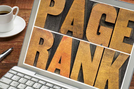 page rank - text in vintage letterpress wood type on a laptop screen - internet and SEO concept Stock Photo