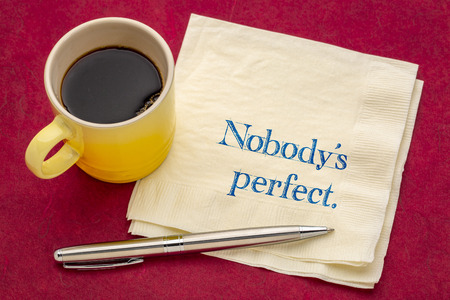 Nobody is perfect - handwriting on a napkin with a cup of coffee