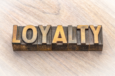 loyalty word in vintage letterpress wood type blocks Reklamní fotografie