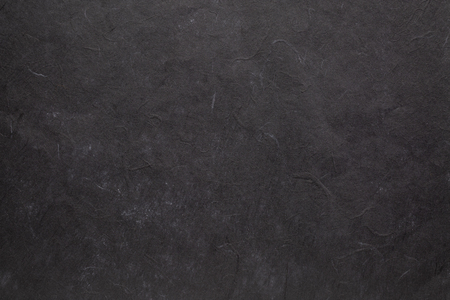 background of black textured handmade mulberry paper