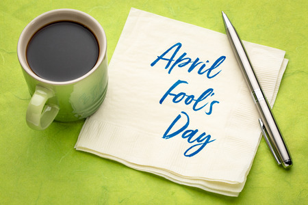 April Fools Day -handwriting on a napkin with a cup of coffee