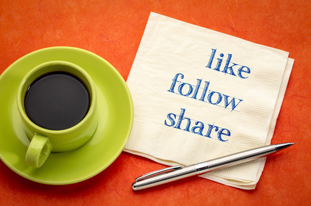 like, follow, share - social media concept - handwriting on a napkin with a cup of coffee Stock Photo