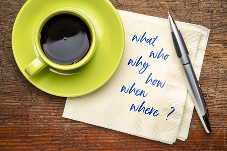who, what, why, how, when and where, brainstorming or decision making questions - handwriting on a napkin with a cup of coffee