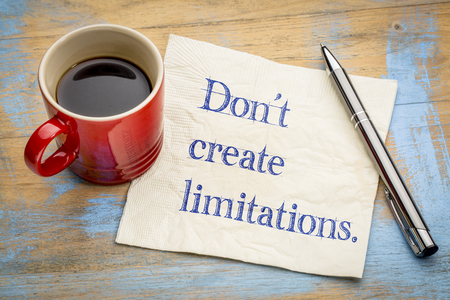 Do not create limitations - handwriting on a napkin with a cup of espresso coffee Reklamní fotografie