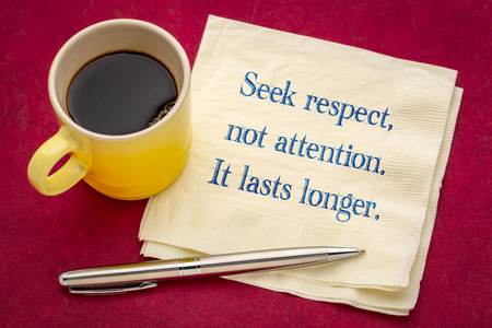 Seek respect, not attention. It lasts longer. Handwriting on a napkin with a cup of coffee Banco de Imagens