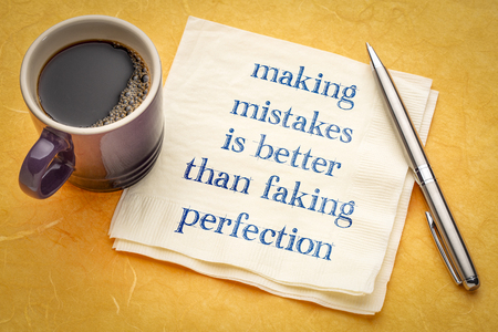 Making mistakes is better than faking perfection - handwriting on a napkin with a cup of coffee