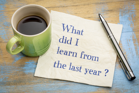 What did I  learn from the last year? Handwriting on a napkin with a cup of espresso coffee Stock Photo
