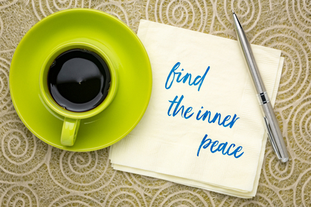 find the inner peace - inspirational handwriting on a napkin with a cup of coffee