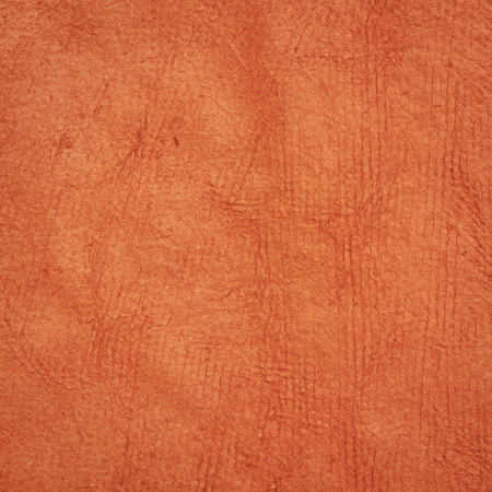 background of pumpkin orange Huun Mayan handmade paper created  by Mayan artisans throughout the Yucatan Peninsula of Mexico 版權商用圖片