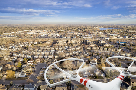 aerial  view of typical residential neighborhood along Front Range of Rocky Mountains with a drone flying Stok Fotoğraf