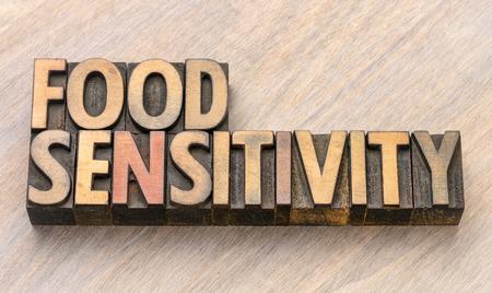 Mot de sensibilité alimentaire dans les blocs d'impression de type bois de typographie vintage Banque d'images