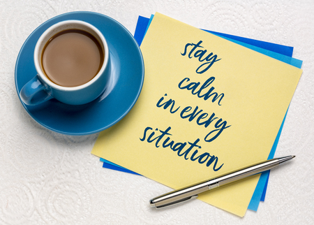 stay calm in every situation - inspirational handwriting on a napkin with a cup of coffee