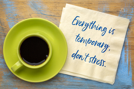 Everything is temporary, do not stress - handwriting on a napkin with a cup of coffee