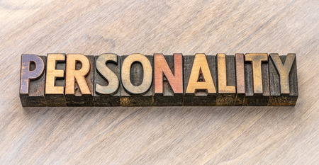 personality - word abstract in vintage letterpress wood type against grained wooden background Imagens