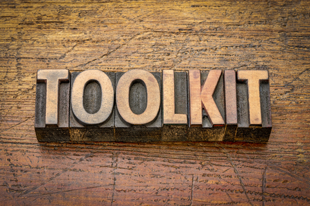 toolkit - word abstract in vintage letterpress wood type against grained wooden background