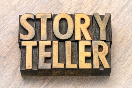 storyteller - word abstract in vintage letterpress wood type against grained wooden background Stock Photo