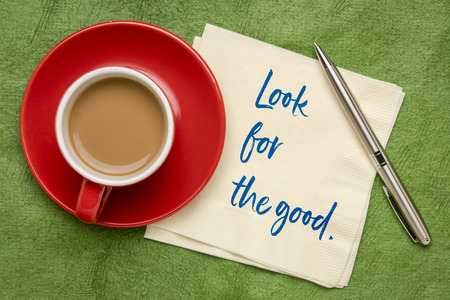 Look for the good inspirational advice - handwriting on a napkin with a cup of coffee