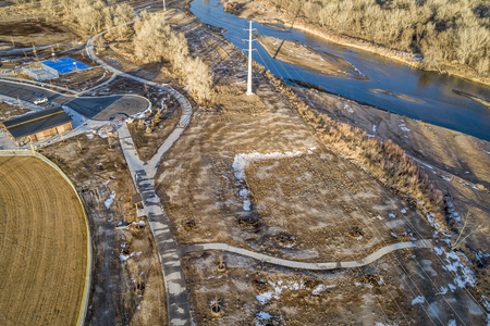 Riverside Park at Evans, Colorado rebuilt after flooding of the South Platte RIver, aerial view in winter scenery