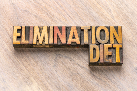 elimination diet word abstract in vintage letterpress wood type printing blocks Stock fotó