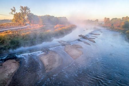 morning fog over South Platte River below Denver in northern Colorado -aerial view
