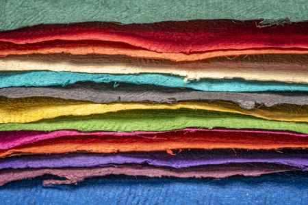 sheets of textured colorful handmade paper created from Sansevieria plant fiber pulp