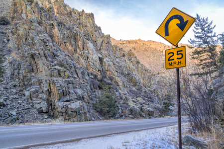 mountain highway with sharp turnings - Poudre River canyon in Rocky Mountains in northern Colorado, winter scenery