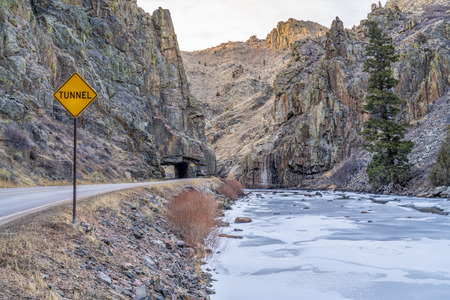 mountain highway with a tunnel - Poudre River canyon in Rocky Mountains in northern Colorado, winter scenery