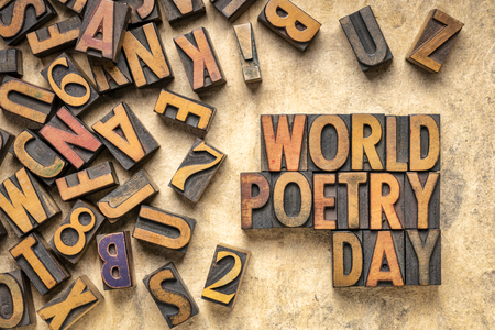 world poetry day - word abstract in vintage letterpress wood type printing blocks Stock Photo