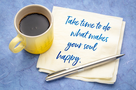 take time to do what makes your soul happy - inspirational handwriting on a napkin with a cup of espresso coffee Фото со стока