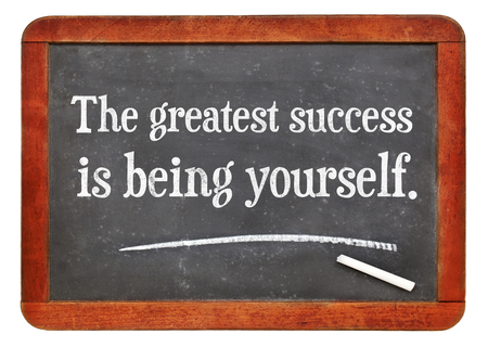 the greatest success is being yourself - white chalk text on a vintage slate blackboard