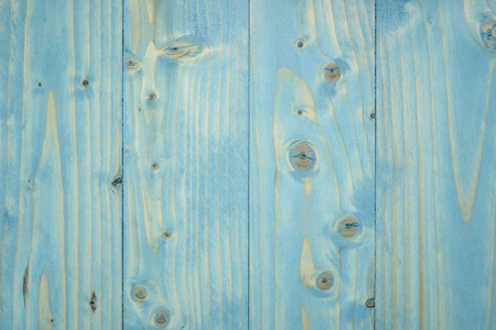 blue painted wooden board with graine and knots