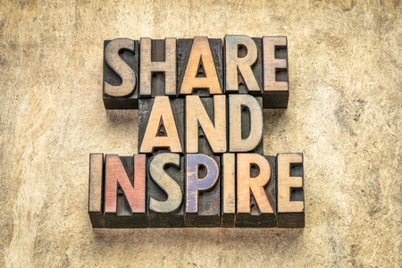 share and inspire word abstract in vintage letterpress  wood type against textured bark paper