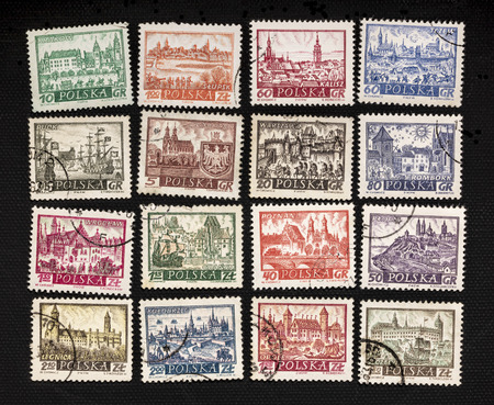 historical representation of famous Polish cities - a set of vintage canceled post stamps on black canvas