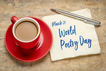 World Poetry Day - handwriting on a napkin with a cup of coffee