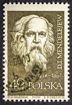 Dmitri Mendeleev, Russian chemist and inventor,  portrait on a vintage, canceled post stamp from Poland (circa 1959).